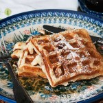 Waffles with syrup and pecans