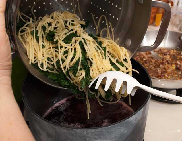 Pour pasta into wine