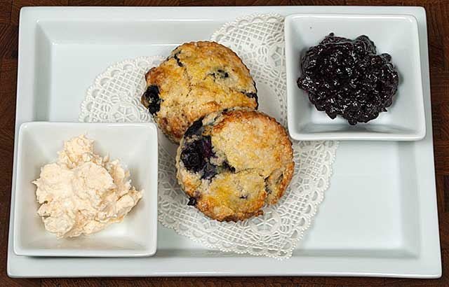 Blueberry scones with clotted cream and blueberry jam