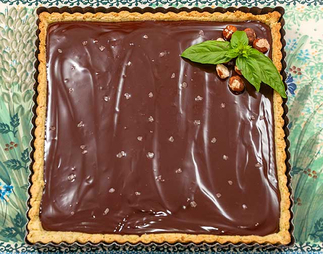 Dark Chocolate and Olive Oil tart with Basil, Hazelnut Crust