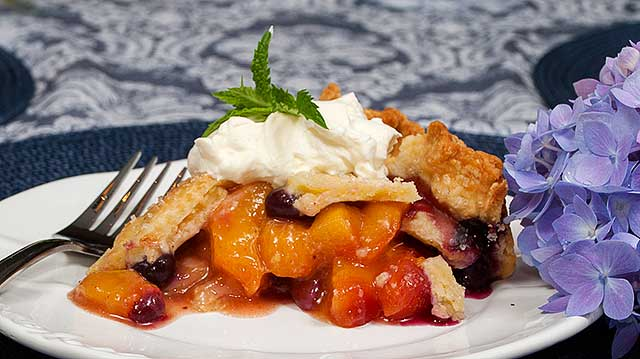 Deep dish peach and blueberry pie with cornmeal crust
