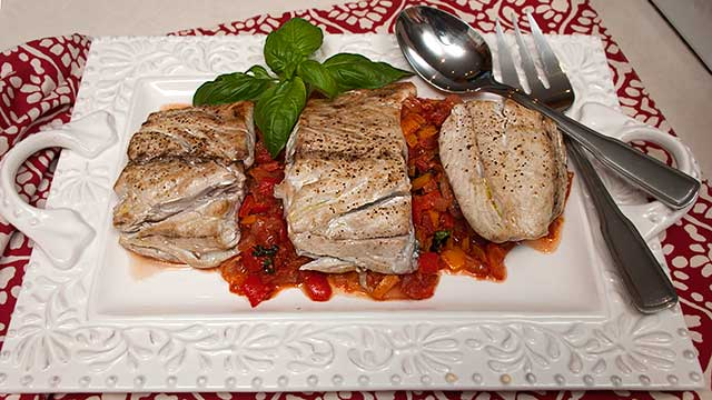 Bluefish with a tomato and green pepper sauce.