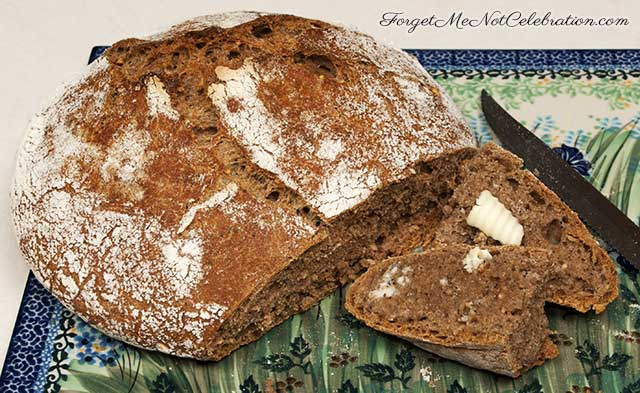 Buttered slice of Dutch oven bread