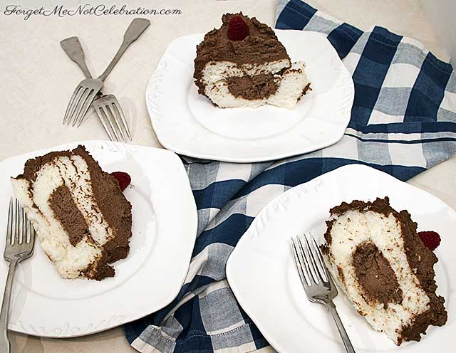 Slices of angel food cake with chocolate whipped cream