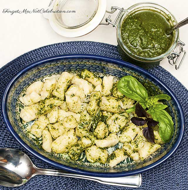 Homemade potato gnocchi with pesto sauce